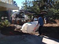 lowering rainwater tank into ground