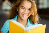 Teenage Girl with A Big Smile Holding a Book