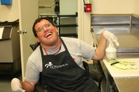 Joe smiling with black apron in cooking class at Applied Abilities in Santa Barbara