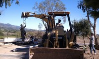Lifting Statue with Backhoe Extended Boom