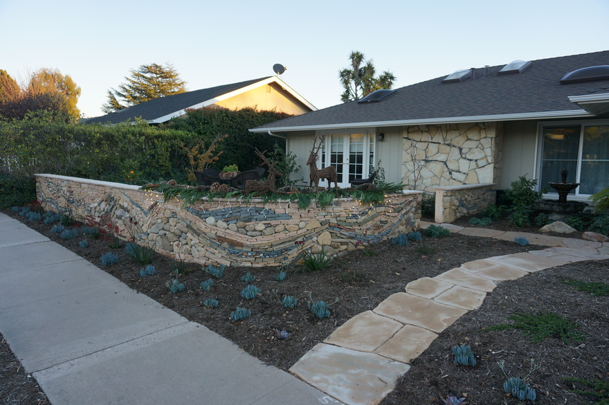 After: drought tolerant garden with walled seating area and pathway