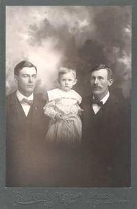Young Roy with father and family
