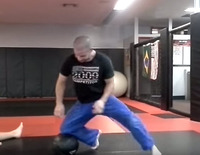 Adam Mazin - Solo Knee on Belly drill on medicine ball.