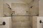 Large Stone Walk-in Shower in Master Bathroom