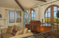 Living Room arched doors to top Deck and Views
