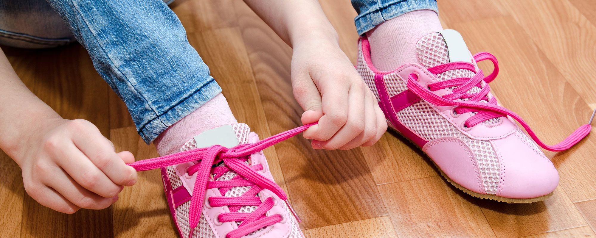 Does your child have difficulty buttoning and zipping clothes or tying shoes?