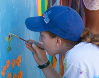 Teen Mural day 2018 - photo from past - close up boy painting