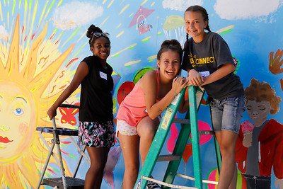 Teen Mural day 2018 - photo from past - three kids on ladder