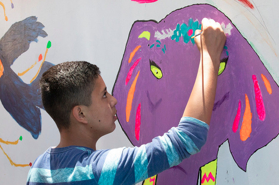 TMP - 2018 one boy painting at teen mural