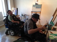 Artists Joe Haake and Brian MacLaren in the studio near their desks working