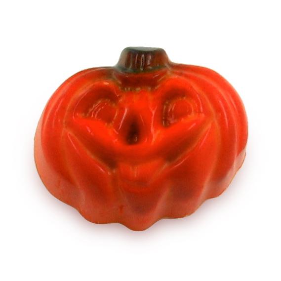 A orange chocolate in a shape of a pumpkin