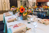 50th anniversary table setting with gerber daisies in centerpiece