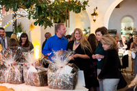 guests at 50th anniversary event looking at raffle prize baskets