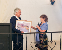 Kathy Webb presents Ron Cohen with a retirement gift of framed watercolor painting