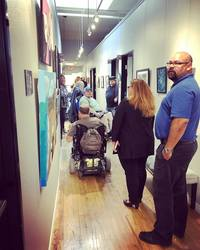 guests walking through the gallery during 1st Thursday exhibition