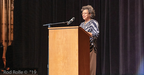 Pres. E. Onja Brown, welcomes Arlington Theater audience