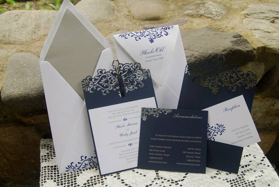 A lovely laser cut card with a pocket on the back to hold the response, receptio...