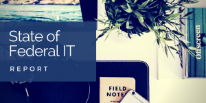 State of Federal IT Report with background image of a desk with a computer screen, plant, and notebook
