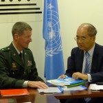 Major General Don T. Riley presents Director-General Koïchiro Matsuura with publications concerning the agreement