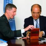Major General Don T. Riley presents Director-General Koïchiro Matsuura with a small gift