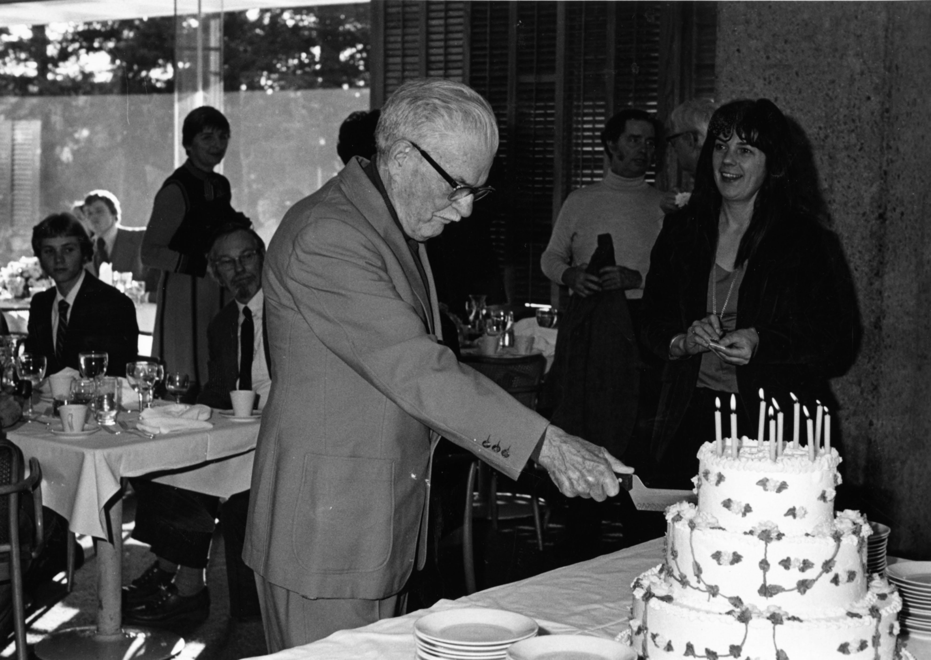 Stringfellow Barr Cutting Cake On His 80th Birthday At Woodrow Wilsons Former Home In Princeton New Jersey