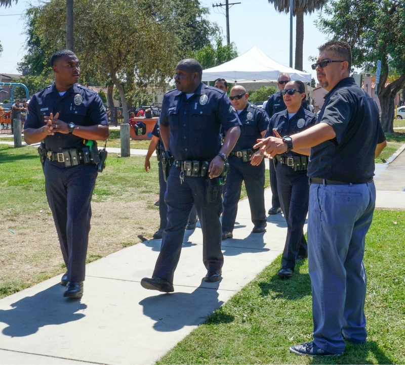lapd officer marcus whitehead center and colleagues taking part in the inaugural community steps event at jackie tatum harvard park in september