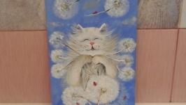 Котик з букетом одуванів