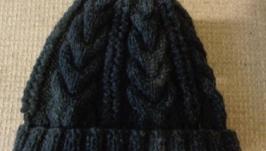 Теплая шапка с косами