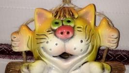 Кіт на качелях
