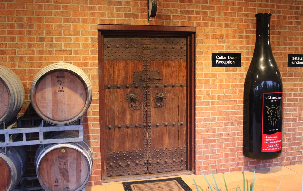 Cellar doors between barrels