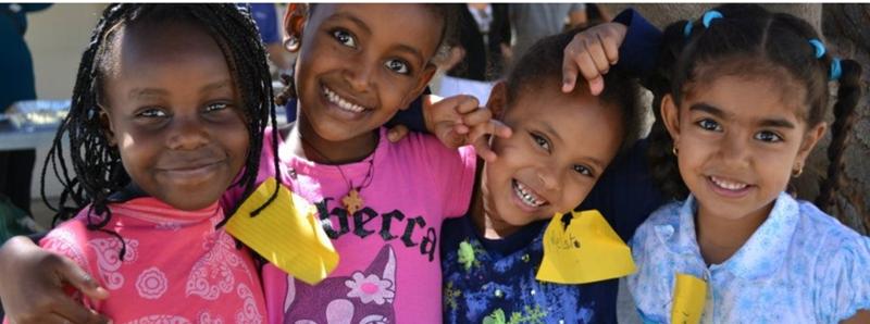 Photo of four refugee children