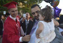Hadi Aljazaeri celebrates with family friend Ali Almarsoomi and his daughter Sana