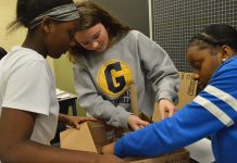 From left, Diamond Johnson, Madisyn Rogers and Jamya Sanders work on their outdoor classroom prototype