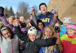 Teacher cadet Tomer Adnegeko at recess at Breton Downs Elementary with a group of enthusiastic admirers
