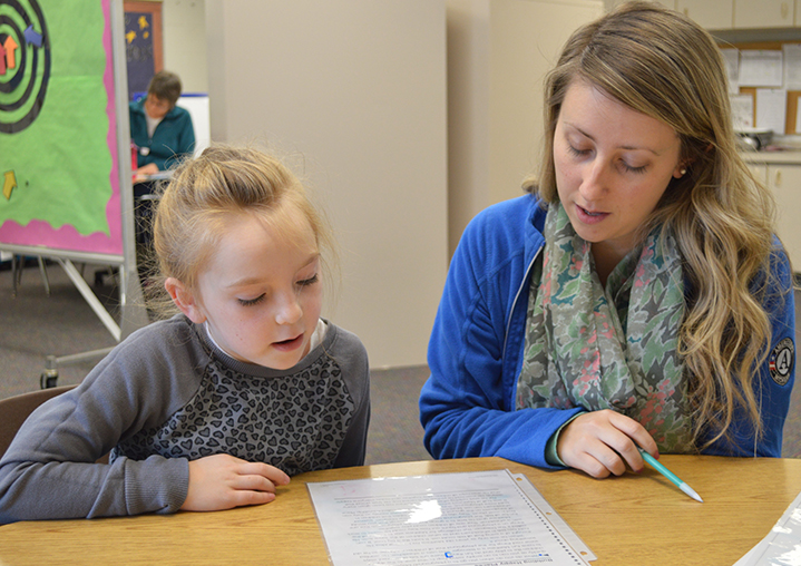 AmeriCorps employee Sarah York works with second-grader Judith Reed
