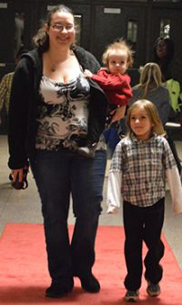 Kristin Jacob and son, kindergartner Josiah, walk the red carpet to applause