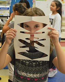 Third-grader Alivia Walker shows her shape