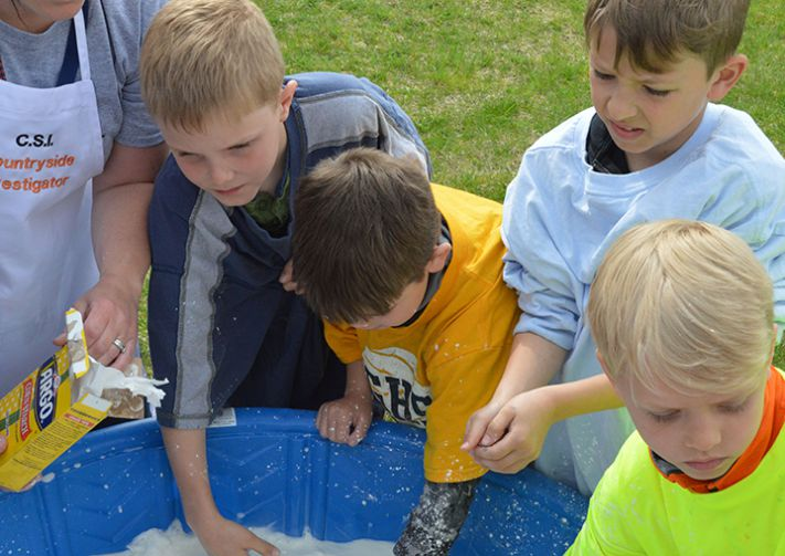 """Students mix up """"ooze"""" with their hands"""
