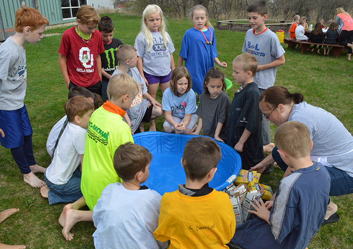Countryside Elementary students prepare to create a unique substance that defies normal properties of matter