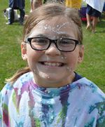 Second-grader Tessa McGowan is sticky but still smiling following the experiment