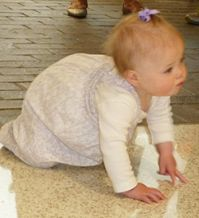 Amara DeJonge, 9 months, crawls off to discover things for herself