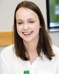 Elisabeta Karlin hopes to return for the graduation of her host sister, Michelle Moore