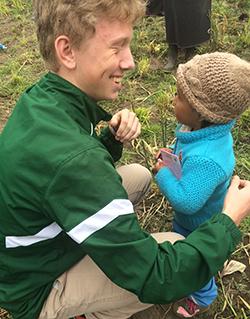 Comstock Park junior Reid Parsons makes a friend during a school trip last spring to Rio Bamba, Ecuador