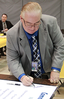 State Superintendent Brian Whiston signs his support for RNN