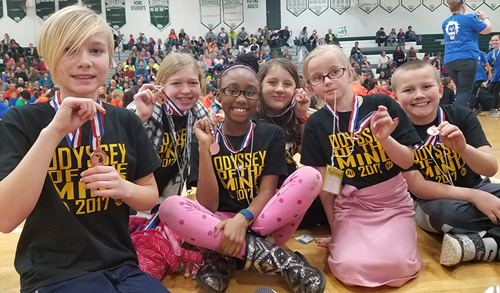 Some members of Alpine Elementary's first-ever Odyssey of the Mind teams happily display their medals