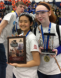 Senior Andy VanZomeren and freshmen Linda Jiao and Madison McGraner proudly display their winning plaque and trophy