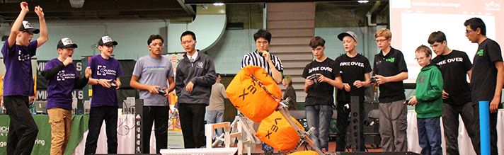 From far left, Caledonia team members Thomas Munson, Spencer Chapp and Colin Pearson react during competition