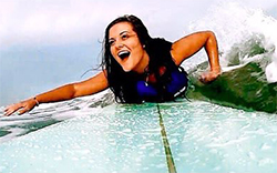 Brittany Seekell, Northern class of 2016, surfing on her board in Florida