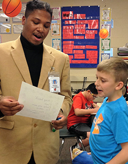 Senior Marshall Kilgore works with Pine Island fifth-grader Matthew Swart on a poetry assignment
