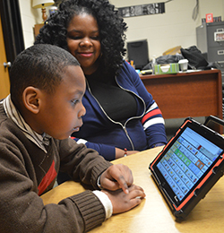 Daniel Donaldson uses his reader with his mom, Christina Donaldson